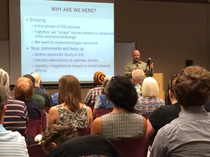 Photo of USFS Deputy Forest Supervisor Tom Torres leading a public meeting